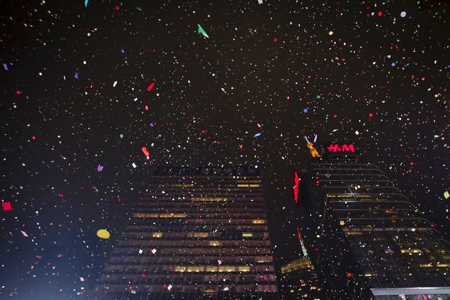 Confetti falls from the sky during New Year celebrations in Times Square in the Manhattan borough of New York, January 1, 2016. (Photo by Carlo Allegri/Reuters)
