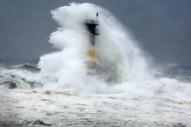 High wave hits a lighthouse as typhoon Neoguri approaches the Korean Peninsula in Seogwipo on Jeju Island , South Korea, Wednesday, July 9, 2014. (Photo by Ko Sung-sik/AP Photo/Yonhap)