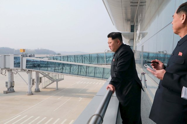 North Korean leader Kim Jong Un (L) gives field guidance at the construction site of Terminal 2 of Pyongyang International Airport, which is nearing completion, in this undated photo released by North Korea's Korean Central News Agency (KCNA) in Pyongyang April 12, 2015. (Photo by Reuters/KCNA)