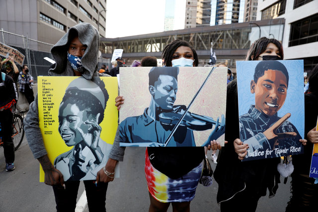 Protesters march on the day of opening statements in the trial of the former police officer Derek Chauvin, who is accused of killing George Floyd last year in Minneapolis, Minnesota on March 29, 2021. (Photo by Octavio Jones/Reuters)