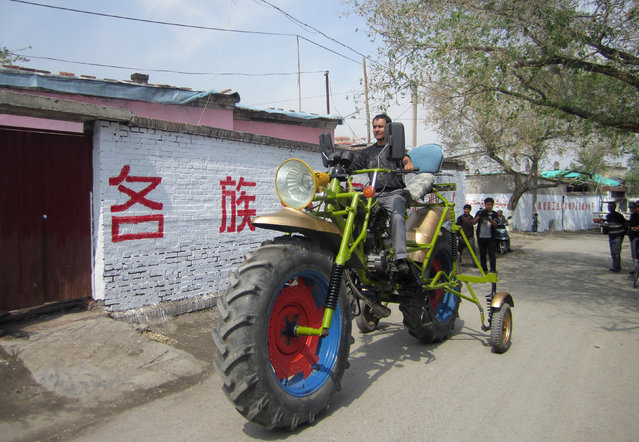 An ethnic Uighur man Abulajon drives his self-made motorcycle during a test in Manas county, Xinjiang Uighur autonomous region, April 27, 2013. Abulajon, a 30-year-old Uighur worker from a sewage treatment plant, spent a year making his 0.3 tonnes motorcycle measuring 4.3 metres (14 feet) in length and 2.4 metres (7.8 feet) in height, although it makes it impossible for him to drive it on the street. It cost him about 8000 yuan ($1300) to buy all the parts from salvage stations and the converted engine can power the motorcycle with a speed of 40 km per hour (24.8 miles per hour), local media reported. (Photo by Reuters/China Daily)