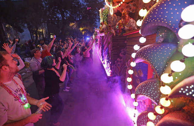 The Krewe of Proteus Mardi Gras parade roles down Napoleon Aveune in New Orleans, Monday, February 16, 2015. (Photo by Gerald Herbert/AP Photo)