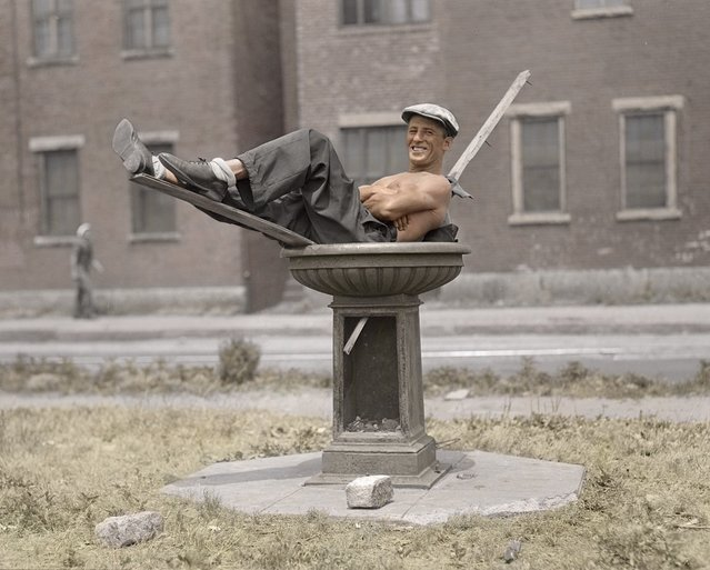 Man cooling off in bird bath on hot day, Boston, c.1930s.