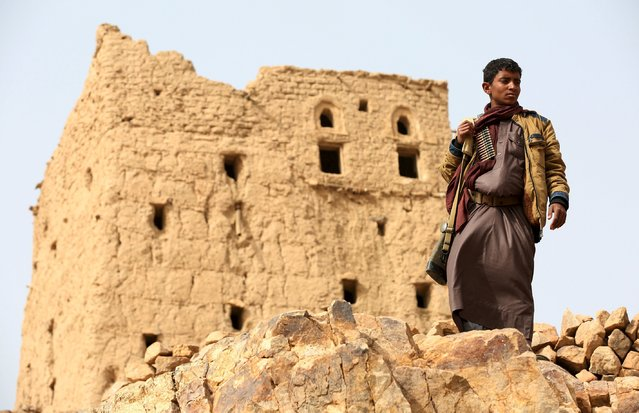 A tribal fighter loyal to Yemen's government stands in Al Khurais village of Nihm district east of the capital Sanaa January 11, 2016. (Photo by Ali Owidha/Reuters)