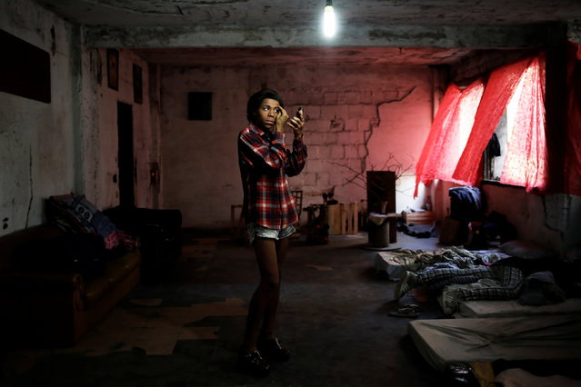 Gaby, 18, who is among members of lesbian, gay, bisexual and transgender (LGBT) community, that have been invited to live in a building that the roofless movement has occupied, puts on make up, in downtown Sao Paulo, Brazil, November 20, 2016. (Photo by Nacho Doce/Reuters)