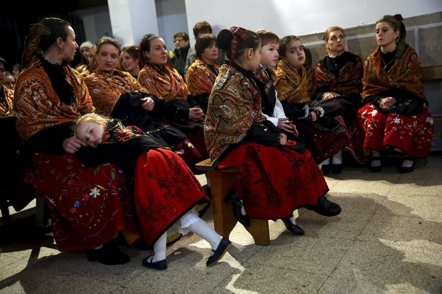 Women and children in traditional attire take part in a mass during the Jarramplas traditional festival in Piornal, southwestern Spain, January 20, 2016. (Photo by Susana Vera/Reuters)