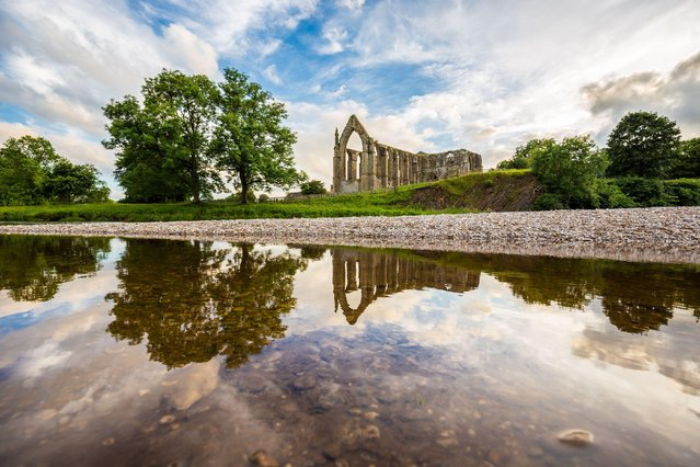 Dave Zdanowicz, a prominent landscape photographer from the north of England, here shares his favourite shots from this year. This series brings together photos from January to last month, displaying the fine range of English seasons he has documented. Here: Reflections by Bolton Abbey, July 16, 2016. (Photo by Dave Zdanowicz/Rex Features/Shutterstock)