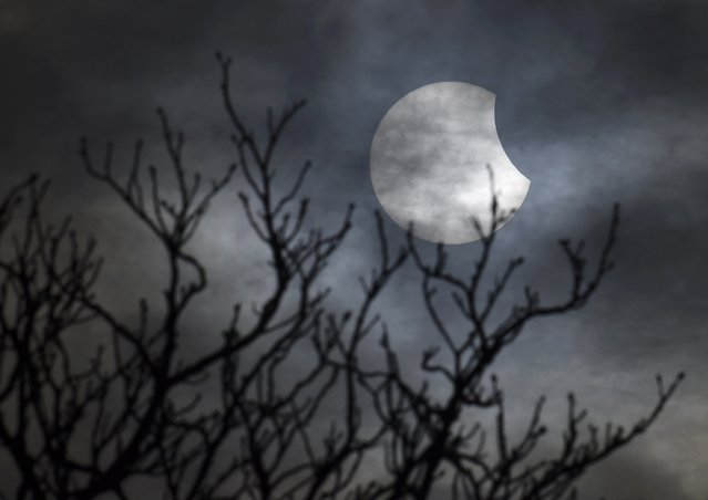 A partial solar eclipse is seen from near Bridgwater, in south western England, March 20, 2015. (Photo by Toby Melville/Reuters)
