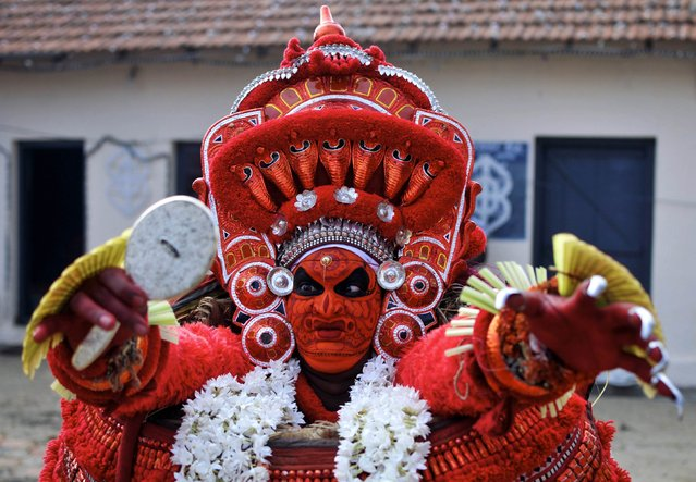 An artist dressed as Hindu god Vishnumurhty performs during the Theyyam ritual in Somwarpet town in the southern Indian state of Karnataka March 17, 2015. (Photo by Abhishek N. Chinnappa/Reuters)