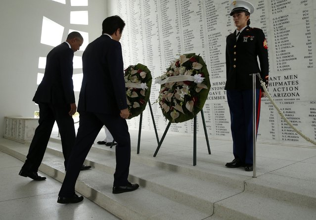 Japanese Prime Minister Shinzo Abe and U.S. President Barack Obama (L) participate in a wreath-laying ceremony aboard the USS Arizona Memorial at Pearl Harbor, Hawaii, U.S., December 27, 2016. (Photo by Kevin Lamarque/Reuters)