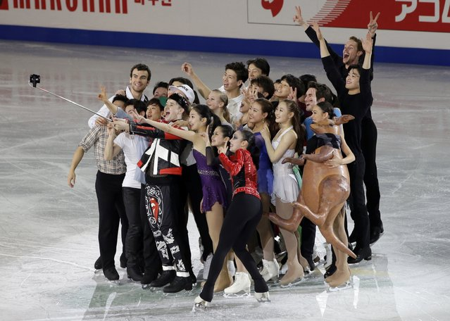 Figure skaters pose for a selfie during the gala exhibition in the ISU Four Continents Figure Skating Championships in Seoul, South Korea, Sunday, February 15, 2015. (Photo by Lee Jin-man/AP Photo)