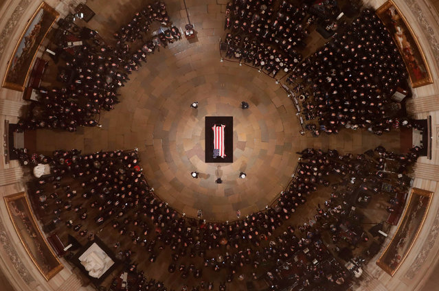 Vice President Mike Pence speaks as Former President George H. W. Bush lies in state in the U.S. Capitol Rotunda in Washington, DC, December 3, 2018. The body of the late former President George H.W. Bush will travel from Houston to Washington, where he will lie in state at the US Capitol through Wednesday morning. Bush, who died on November 30, will return to Houston for his funeral on Thursday. (Photo by Morry Gash/AFP Photo)