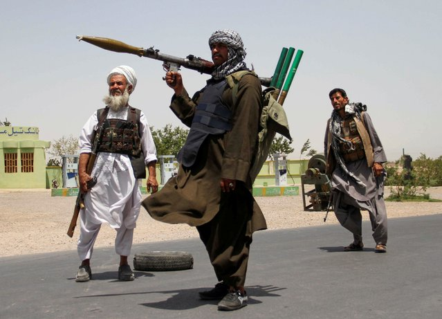 Former Mujahideen hold weapons to support Afghan forces in their fight against Taliban, on the outskirts of Herat province, Afghanistan on July 10, 2021. (Photo by Jalil Ahmad/Reuters)