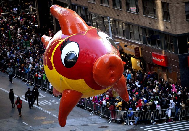 A float makes its way down Sixth Avenue. (Photo by Carlo Allegri/Reuters)