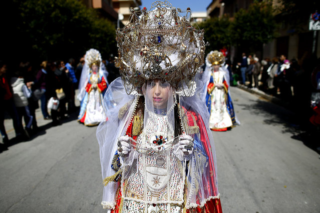 Penitents take part in a Holy Week procession in Marsala, southern Italy, April 2, 2015. Tens of Easter processions take place around Sicily island during Holy Week, drawing thousands of visitors. (Photo by Tony Gentile/Reuters)