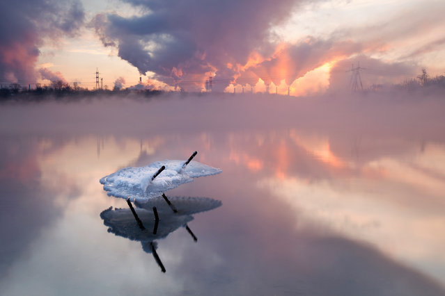 """Winter shapes, Moscow river"". Moscow river at this part is never covered by ice. When the temperature is very low it's possible to see a strong fog. Morning light and pipes of the oli factory creates a fantastic landscape. Photo location: Moscow, Russia. (Photo and caption by Sergey Rumyantsev/National Geographic Photo Contest)"