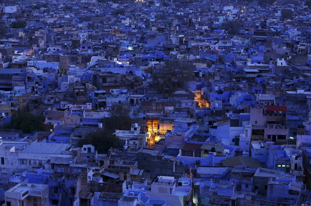 A general view of the residential area is pictured during dusk at Jodhpur in Rajasthan, April 5, 2015. Jodhpur, also known as the blue city in the desert Indian state of Rajasthan, which residents say originally, was used to show where the highest caste of priestly Hindus live, who wanted to set them apart from the rest of the population. Later the rest of the population followed suit. Another reason for the city to be blue is to keep the buildings cool during the summers, local residents said. (Photo by Adnan Abidi/Reuters)