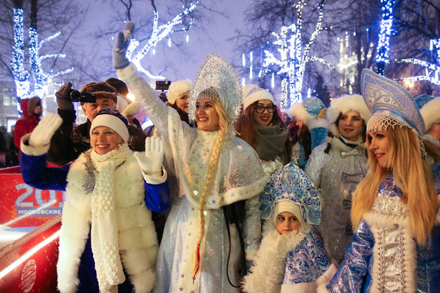 Women wearing Snegurochka (Snow Maiden) costumes, the traditional companion of Ded Moroz, attend a Parade of Snow Maidens on Tverskoi Boulevard in Moscow, Russia on January 12, 2017. (Photo by Artyom Geodakyan/TASS)