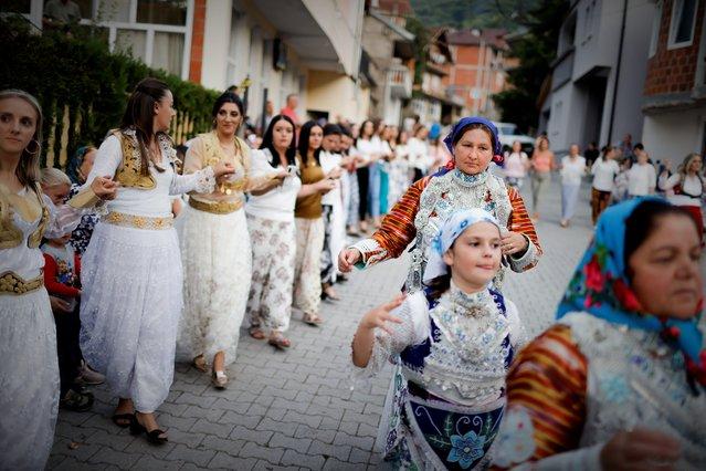 Kosovar Bosnian women are dancing during the traditional wedding ceremony in the village of Donje Ljubinje, Kosovo, 14 August 2021. (Photo by Valdrin Xhemaj/EPA/EFE)
