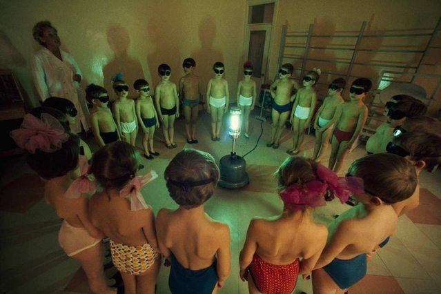 In honor of our 125th anniversary, we're sharing National Geographic photographs – many never before published – that reveal cultures and moments of the past. In this one, taken in 1977 by Dean Conger, children in Murmansk, U.S.S.R., circle around an ultraviolet lamp to get a dose of vitamin D. (Photo by Dean Conger/National Geographic)
