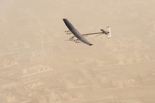 A view of the Solar Impulse 2 on flight after taking off from Al Bateen Airport in United Arab Emirates, March 9, 2015. (Photo by Jean Revillard/Reuters)