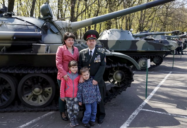 A Ukrainian army officer poses for a picture with his family after a graduation ceremony at the National University of Defence of Ukraine in Kiev, Ukraine April 24, 2015. (Photo by Gleb Garanich/Reuters)