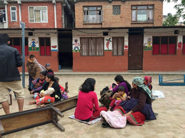 People take refuge at a school after a 7.7 magnitude earthquake struck in Kathmandu, Nepal, April 25, 2015. The earthquake struck 80 km (50 miles) east of Pokhara in Nepal on Saturday, about half-way between the town and the capital Kathmandu, the U.S. Geological Survey said, and witnesses said some buildings in Kathmandu had collapsed. (Photo by Navesh Chitrakar/Reuters)