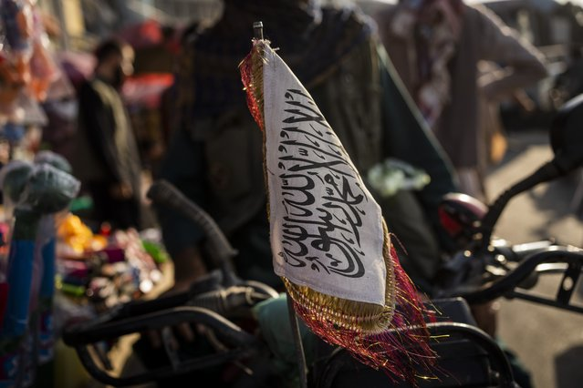 A Taliban flag is placed in the front of a motorbike in Kabul, Afghanistan, Tuesday, September 28, 2021. (Photo by Bernat Armangue/AP Photo)