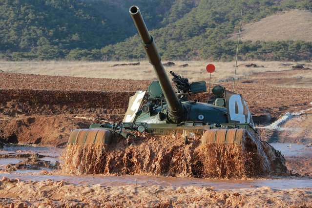 A tank is seen during the Korean People's Army (KPA) tank crews' competition at an unknown location, in this undated photo released by North Korea's Korean Central News Agency (KCNA) in Pyongyang on March 11, 2016. (Photo by Reuters/KCNA)