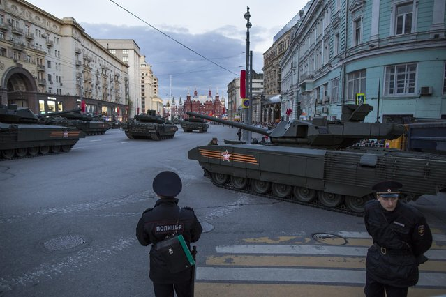 The New Russian T-14 Armata tanks prepare to make their way to Red Square with the Historical Museum, in the background, during a rehearsal for the Victory Day military parade which will take place at Moscow's Red Square on May 9 to celebrate 70 years after the victory in WWII, in Moscow, Russia, Monday, May 4, 2015. (Photo by Alexander Zemlianichenko/AP Photo)