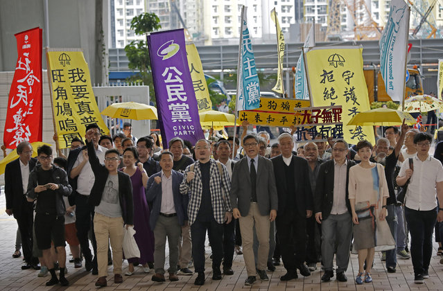 "Occupy Central leaders, from right, Tommy Cheung, Tanya Chan, Benny Tai, Chu Yiu-ming, Chan Kin-man, Shiu Ka-chun, Lee Wing-tat, Raphael Wong and Eason Chung arrive at a court in Hong Kong, Wednesday, April 10, 2019. Nine pro-democracy activists returned to court Wednesday in Hong Kong to await their verdicts after having been found guilty of various offenses in relation to the 2014 ""Occupy Central"" protest, which paralyzed city streets in the southern Chinese territory. (Photo by Vincent Yu/AP Photo)"