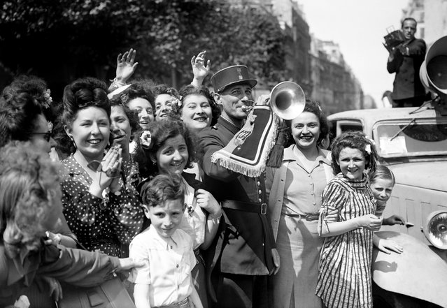 Picture dated of May 8, 1945 showing Parisians celebrating the unconditionnal German capitulation in the streets of Paris, at the end of the second World War. (Photo by AFP/Getty Images)