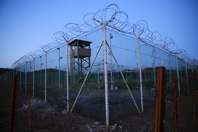 Chain link fence and concertina wire surrounds a deserted guard tower within Joint Task Force Guantanamo's Camp Delta at the U.S. Naval Base in Guantanamo Bay, Cuba March 21, 2016. (Photo by Lucas Jackson/Reuters)
