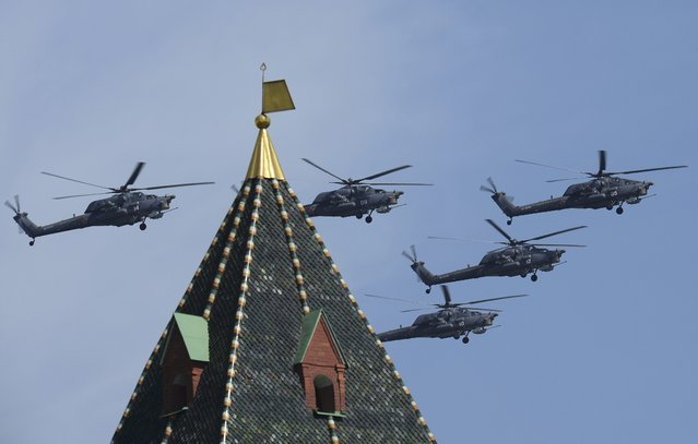 Russian Mil Mi-28N Havoc helicopters fly in formation over the Red Square during the Victory Day parade in Moscow, Russia, May 9, 2015. (Photo by Reuters/Host Photo Agency/RIA Novosti)