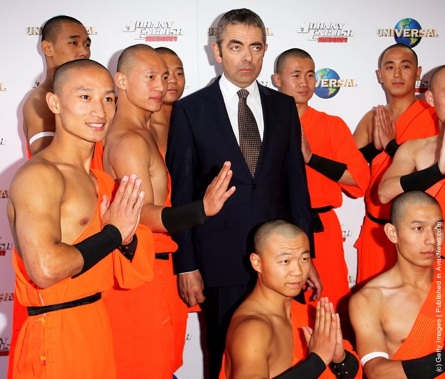 Rowan Atkinson poses with Shaolin Monks, Johnny English Reborn World Premiere