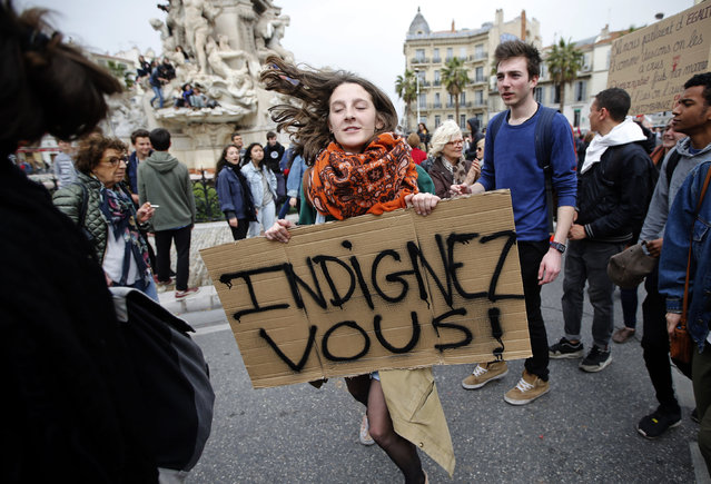 """French high school and university students attend a demonstration against the French labour law proposal in Marseille, France, as part of a nationwide labor reform protests and strikes, March 31, 2016. The slogan reads """"Indignez-Vous !"""" (Time for Outrage!). (Photo by Jean-Paul Pelissier/Reuters)"""