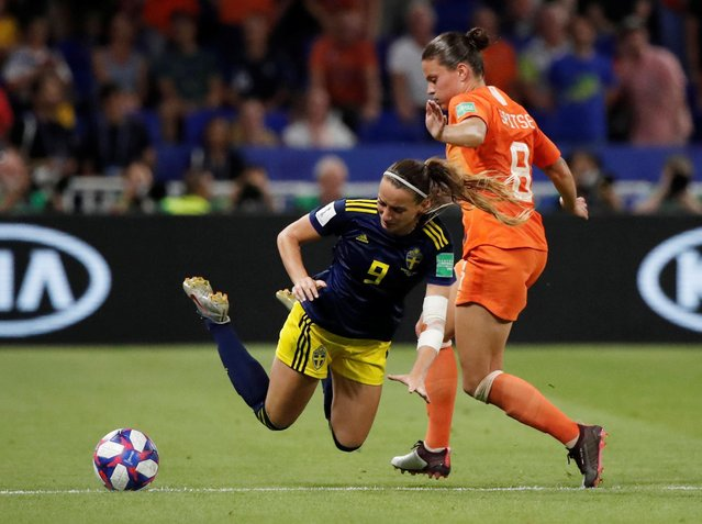 Sweden's midfielder Kosovare Asllani (L) vies for the ball with Netherlands' midfielder Sherida Spitse during the France 2019 Women's World Cup semi-final football match between the Netherlands and Sweden, on July 3, 2019, at the Lyon Stadium in Decines-Charpieu, central-eastern France. (Photo by Benoit Tessier/Reuters)