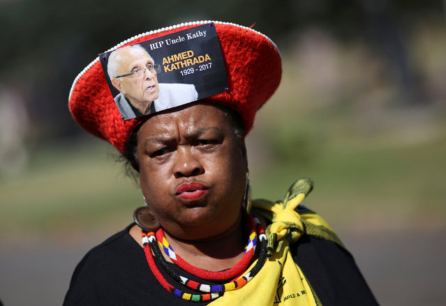 A mourner arrives wearing a hat bearing a picture of Ahmed Kathrada, who was sentenced to life imprisonment alongside Nelson Mandela, during his funeral at the Westpark Cemetery in Johannesburg, South Africa, March 29, 2017. (Photo by Siphiwe Sibeko/Reuters)