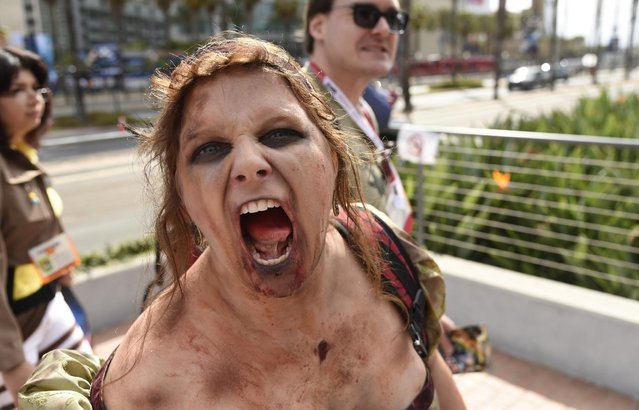 Jarina Montgomery, of San Diego, Calif., dressed as a Zombie, walks outside the Convention Center  on day 1 of Comic-Con International on Thursday, July 9, 2015, in San Diego, Calif. (Photo by Chris Pizzello/Invision/AP Photo)