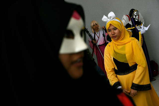 "Muslim cosplay enthusiasts take part in the ""Hijab Cosplay"" event in Subang Jaya, outside of Kuala Lumpur, on April 29, 2017. (Photo by Manan Vatsyayana/AFP Photo)"