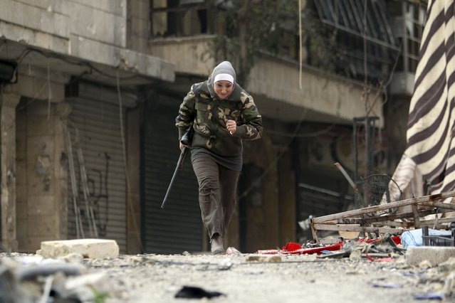 Guevara, a Syrian Palestinian woman married to an Al Wa'ad battalion commander, runs in Aleppo January 19, 2013. (Photo by Muzaffar Salman/Reuters)