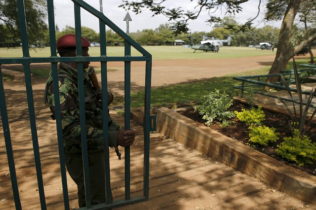 A Kenyan security officer stands watch at the compound where U.S. President Barack Obama's Marine One helicopter detail waits for him, near the United Nations compound in Nairobi, Kenya July 25, 2015. (Photo by Jonathan Ernst/Reuters)