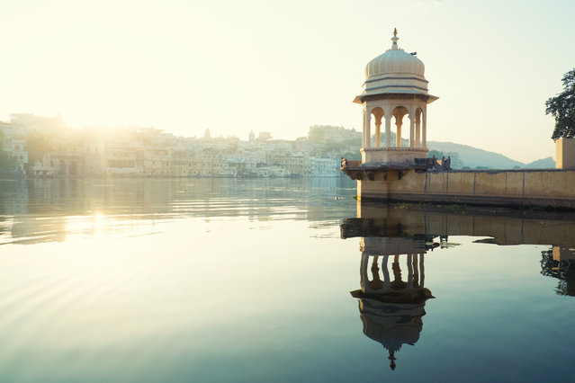 """""""Temple Jetty Udaipur"""". This was one of my favourite places in Udaipur. A small temple on the banks of lake Pichola. The light was amazing here early in the morning, and with only a handful of locals using it for prayers its was so peaceful and quiet. Photo location: Udaipur, india. (Photo and caption by Luke Hahn/National Geographic Photo Contest)"""