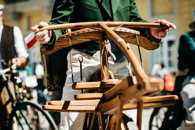 Participants dressed in historical clothing ride high-wheel bicycles during a bicycle ballet event at Schloss Karlsruhe palace during the 2017 International Veteran Cycle Association (IVCA) rally to celebrate the 200th anniversary of the bicycle on May 27, 2017 in Karlsruhe, Germany. (Photo by Alexander Scheuber/Getty Images)
