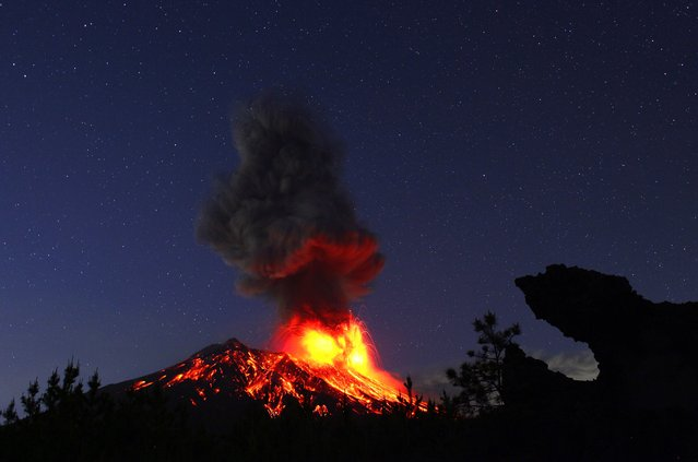 """""""Japan is called a volcanic archipelago, yet Sakurajima is the only home to mountains that erupt almost daily. The Lava-spewing craters are the physical link of this world and the earth's inaccessible interior. All of the earth is born from this fire and turns to rock"""". – Takehito Miyatake. (Photo by Takehito Miyatake/Steven Kasher Gallery)"""