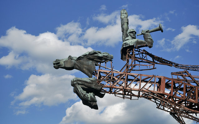 A picture made available on 07 June 2016 shows a Soviet monument, disassembled by people, near an urban-type settlement Olesko, Lviv region, western Ukraine, 06 June 2016. Ukraine approved the law on the decommunization of the country in May 2015. The country's deputies ordered to rename more than 160 cities and villages. Additionally, the Ukrainian Ministry of Culture gave way to demolish about 800 Soviet monuments. (Photo by Pavlo Palamarchuk/EPA)