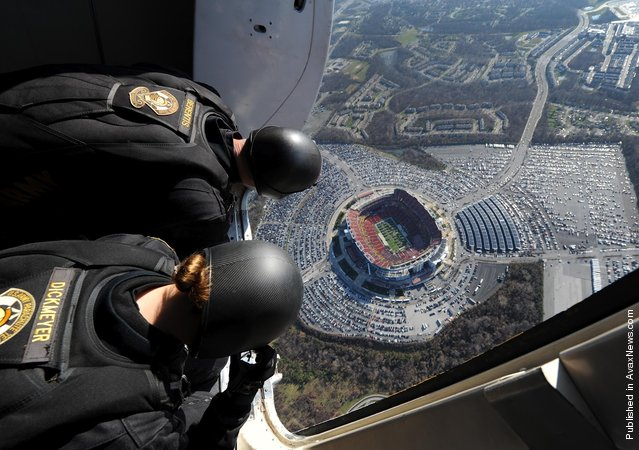 Members of the U.S. Army Parachute Team, Sgt. 1st Class John Berentis of Yuma, Ariz., and Staff Sgt. Laura Dickmeyer of Abilene, Tex., assess the wind conditions before their pregame jump into FedEx Field in Landover for the Army vs. Navy game