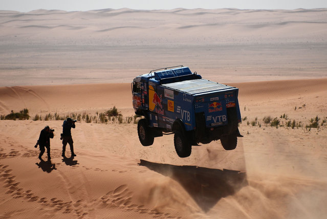 Kamaz' Russia driver Andrey Karginov, co-driver Andrey Mokeev and Igor Lenonov compete during the Stage 6 of the Dakar 2020 between Ha'il and Riyadh, Saudi Arabia, on January 10, 2020. (Photo by Franck Fife/AFP Photo)