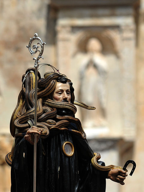 A statue of Saint Domenico surrounded by snakes is held up by worshippers during an annual procession dedicated to the saint, in the streets of Cocullo, in the Abruzzo region, on May 1, 2012