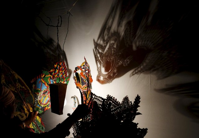 A traditional shadow puppet show, known locally as Wayang Kulit, is performed in Kuala Lumpur, Malaysia, August 9, 2015. (Photo by Olivia Harris/Reuters)
